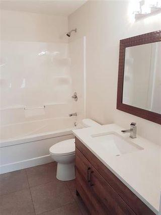 Photo 10: 805 Vaughan Avenue in Selkirk: R14 Residential for sale : MLS®# 202124826