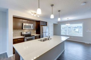 Photo 9: 72 Sunvalley Road: Cochrane Row/Townhouse for sale : MLS®# A1152230