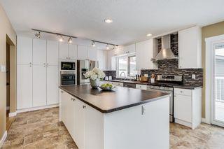 Photo 10: 1108 120 Avenue SE in Calgary: Lake Bonavista Detached for sale : MLS®# A1084362