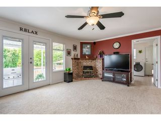 """Photo 11: 6495 180 Street in Surrey: Cloverdale BC House for sale in """"Orchard Ridge"""" (Cloverdale)  : MLS®# R2396953"""