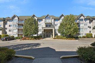 "Photo 1: 406 33688 KING Road in Abbotsford: Poplar Condo for sale in ""College Park"" : MLS®# R2199460"