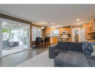 """Photo 10: 18276 69 Avenue in Surrey: Cloverdale BC House for sale in """"Cloverwoods"""" (Cloverdale)  : MLS®# R2369738"""