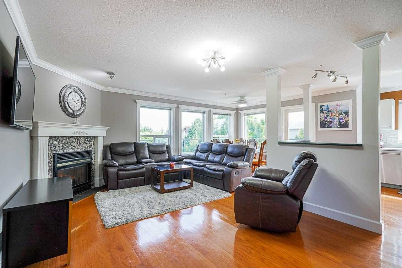 Main Photo: 405 33718 KING Road: Condo for sale in Abbotsford: MLS®# R2592983