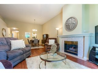 """Photo 7: 106 19649 53 Avenue in Langley: Langley City Townhouse for sale in """"Huntsfield Green"""" : MLS®# R2595915"""