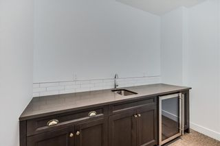 Photo 34: 152 ROCK LAKE View NW in Calgary: Rocky Ridge Detached for sale : MLS®# A1062711