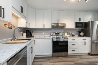 """Photo 15: 303 5909 177B Street in Surrey: Cloverdale BC Condo for sale in """"Carriage Court"""" (Cloverdale)  : MLS®# R2617763"""