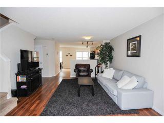 Photo 7: 318 TOSCANA Gardens NW in Calgary: Tuscany House for sale : MLS®# C4116517