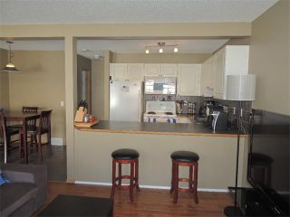 Photo 8: 37 MILLVIEW Green SW in Calgary: Millrise House for sale : MLS®# C4015611