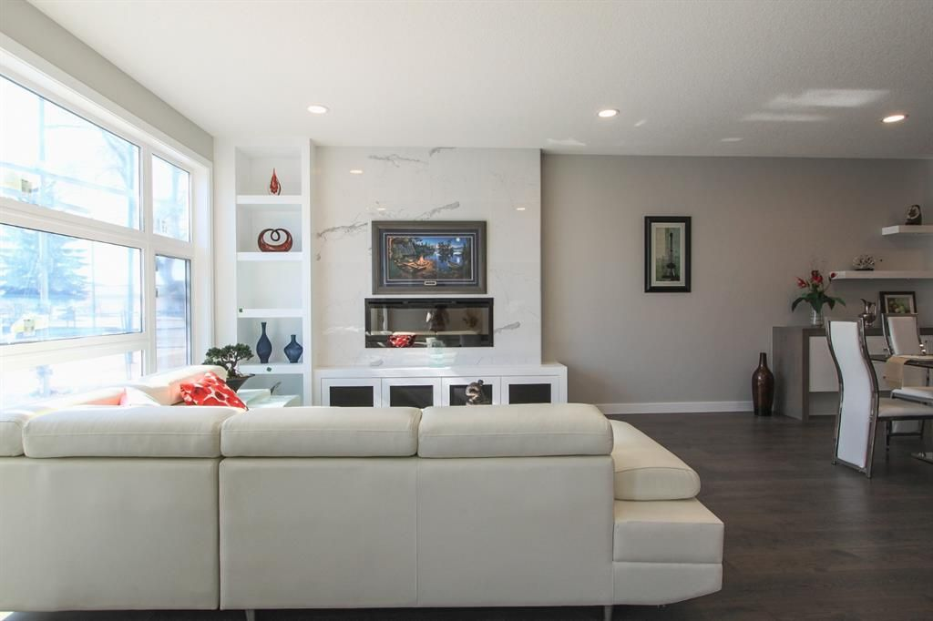 Main Photo: 2410 54 Avenue SW in Calgary: North Glenmore Park Semi Detached for sale : MLS®# A1082680