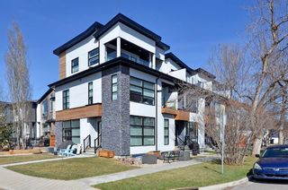 Photo 1: 154 21 Avenue NW in Calgary: Tuxedo Park Row/Townhouse for sale : MLS®# A1098746