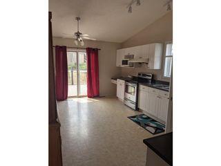 Photo 2: 13028 139 Street in Edmonton: House for rent