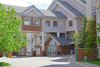 Photo 1: 320 223 Tuscany Springs Boulevard NW in Calgary: Tuscany Apartment for sale : MLS®# A1132465