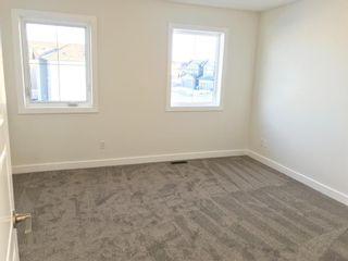 Photo 27: 11 Sundown Manor: Cochrane Semi Detached for sale : MLS®# A1071566