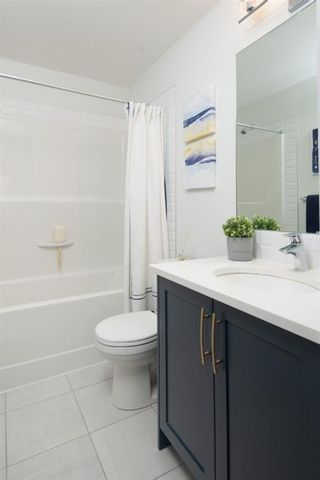 Photo 16: 25 Evanscrest Park NW in Calgary: Evanston Row/Townhouse for sale : MLS®# A1067562