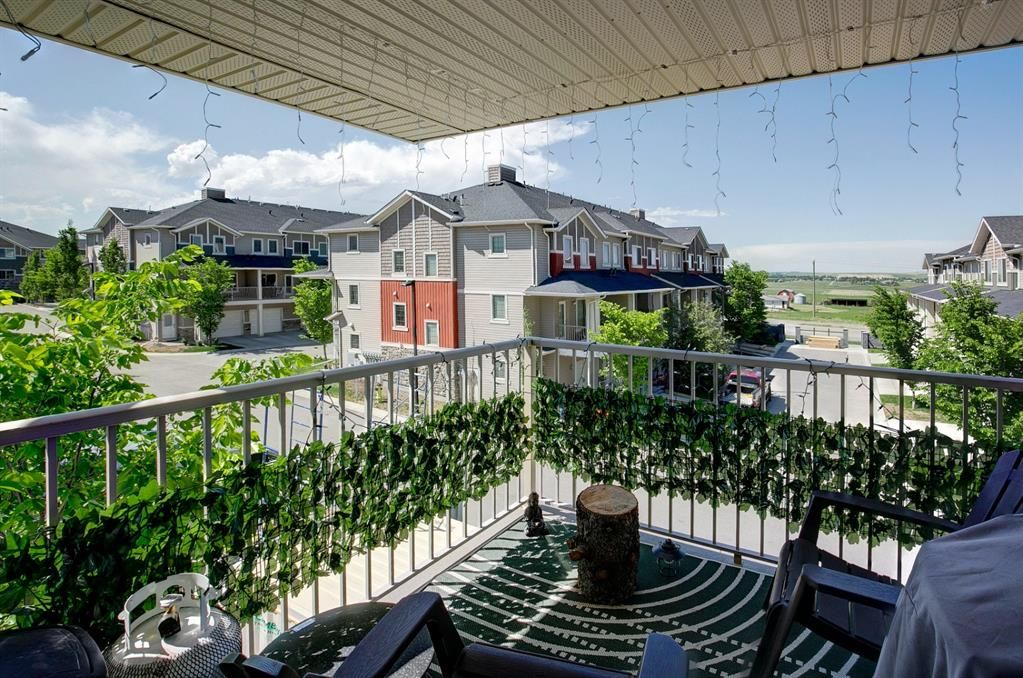 Main Photo: 1714 250 Sage Valley Road NW in Calgary: Sage Hill Row/Townhouse for sale : MLS®# A1120292
