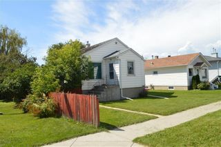 Photo 2: 139 20 Avenue NE in Calgary: Tuxedo Park Detached for sale : MLS®# A1100798