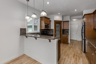 Photo 12: 370 River Heights Drive: Cochrane Detached for sale : MLS®# A1142492