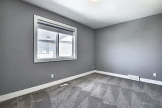 Photo 25: 105 KINNIBURGH Bay: Chestermere Detached for sale : MLS®# A1116532