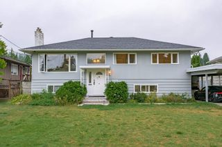 Main Photo: 919 DUNDONALD Drive in Port Moody: Glenayre House for sale : MLS®# R2625619