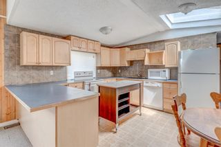 Photo 8: 214 Erin Woods Circle SE in Calgary: Erin Woods Detached for sale : MLS®# A1120105