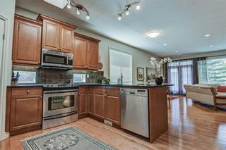 Photo 7: 7 ELYSIAN Crescent SW in Calgary: Springbank Hill Semi Detached for sale : MLS®# A1104538