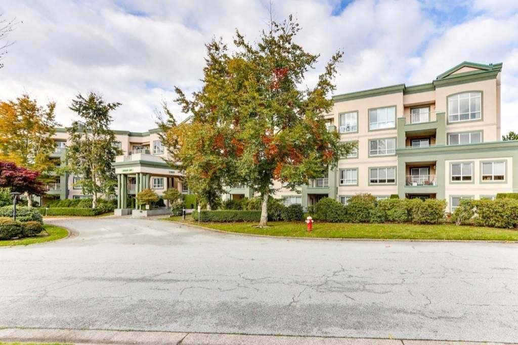 "Main Photo: 322 13880 70 Avenue in Surrey: East Newton Condo for sale in ""Chelsea Gardens"" : MLS®# R2563215"