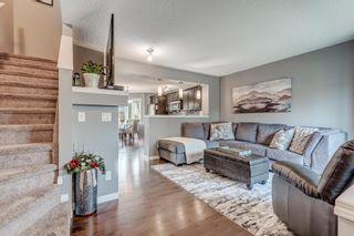 Photo 3: 61 Auburn Springs Boulevard SE in Calgary: Auburn Bay Semi Detached for sale : MLS®# A1135621