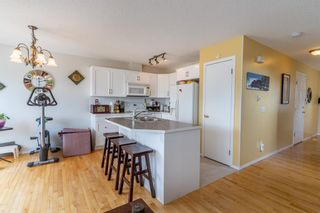 Photo 12: 112 Rocky Vista Circle NW in Calgary: Rocky Ridge Row/Townhouse for sale : MLS®# A1125808