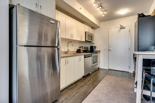 Photo 7: 303 450 8 Avenue SE in Calgary: Downtown East Village Apartment for sale : MLS®# A1076928