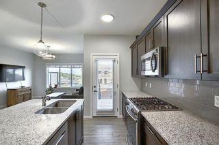 Photo 5: 44 Emberside Place: Cochrane Semi Detached for sale : MLS®# A1036728