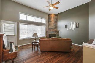 Photo 4: 105 Rocky Ridge Court NW in Calgary: Rocky Ridge Row/Townhouse for sale : MLS®# A1069587