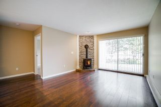 """Photo 7: 102 5379 205 Street in Langley: Langley City Condo for sale in """"Heritage Manor"""" : MLS®# R2447555"""