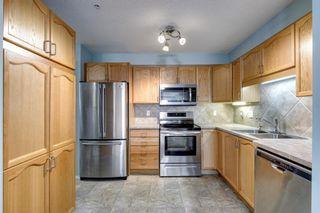 Photo 4: 1205 200 Community Way: Okotoks Apartment for sale : MLS®# A1107550