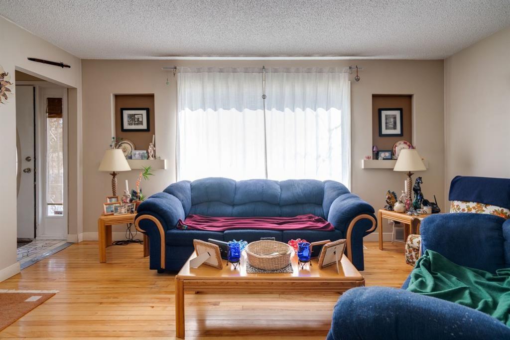 Comfortable living room with hardwood floors...