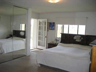 Photo 6: MIRA MESA Residential for sale : 4 bedrooms : 9056 CADE TER in San Diego