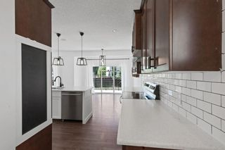 Photo 7: 63 Autumn Place SE in Calgary: Auburn Bay Detached for sale : MLS®# A1122443