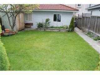 Photo 7: 7327 FRASER Street in Vancouver: South Vancouver 1/2 Duplex for sale (Vancouver East)  : MLS®# V843279
