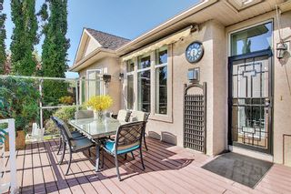 Photo 10: 31 Strathlea Common SW in Calgary: Strathcona Park Detached for sale : MLS®# A1147556