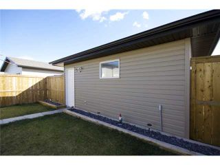 Photo 18: 449 LUXSTONE Place SW: Airdrie Residential Detached Single Family for sale : MLS®# C3542456