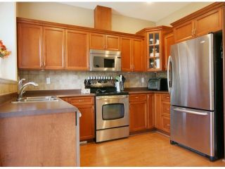 """Photo 7: 6 15168 66A Avenue in Surrey: East Newton Townhouse for sale in """"Porter's Cove"""" : MLS®# F1428816"""