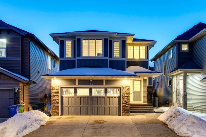 FEATURED LISTING: 144 Cougar Ridge Manor Southwest Calgary