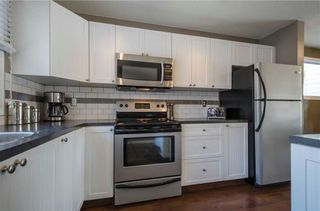Photo 11: 75 SUMMERWOOD Road SE: Airdrie House for sale : MLS®# C4174518