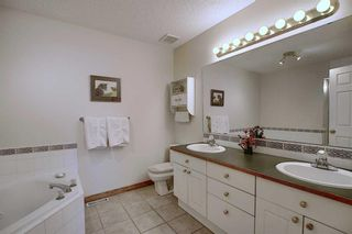 Photo 17: 13 Strathearn Gardens SW in Calgary: Strathcona Park Semi Detached for sale : MLS®# A1114770