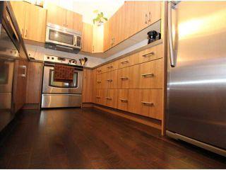 Photo 4: 517 10 AUBURN BAY Avenue SE in Calgary: Auburn Bay Townhouse for sale : MLS®# C3603479