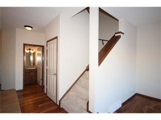Photo 15: 103 WEST POINTE Court: Cochrane House for sale : MLS®# C4042878