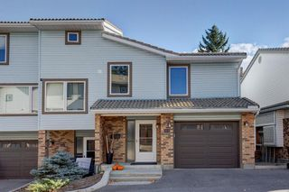 Photo 3: 212 Coachway Lane SW in Calgary: Coach Hill Row/Townhouse for sale : MLS®# A1153091