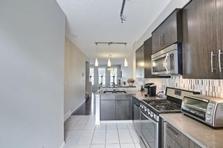 Photo 2: 314 Ascot Circle SW in Calgary: Aspen Woods Row/Townhouse for sale : MLS®# A1111264