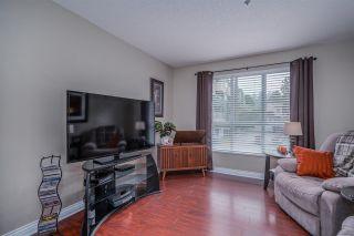 "Photo 7: 202 13860 70 Avenue in Surrey: East Newton Condo for sale in ""Chelsea Gardens"" : MLS®# R2526715"