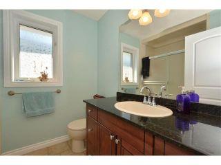 Photo 42: 148 GLENEAGLES Close: Cochrane House for sale : MLS®# C4010996