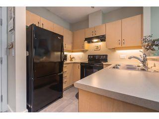 Photo 4: 126 10838 CITY PARKWAY in Surrey: Whalley Condo for sale (North Surrey)  : MLS®# R2391919